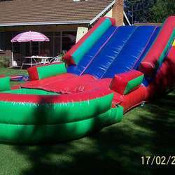 A Ball Slide Castle and more - Jumping castles,Choc Fountain, Kiddies tables and chairs and party tent incl. slides,maze,wiggly worm and pony castle.