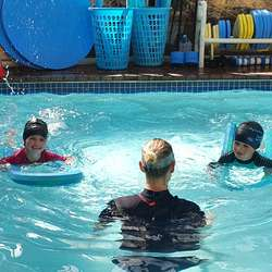 Aquarius Aquatics Swim School - Swimming lessons for infants, children & adult LTS.  Swim school with indoor heated pool