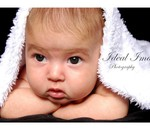 Ideal Images - Photographer for family, maternity, child and baby, portraits along with special functions.
