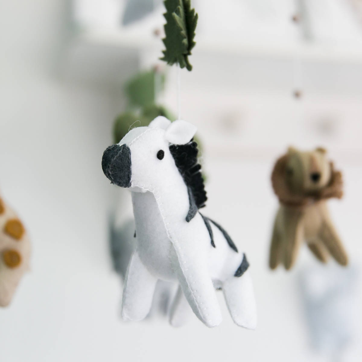 Win a beautiful African felt baby mobile worth R560