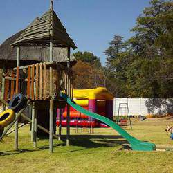 Purple Pig Party Venue - Exclusive Use Children's Outdoor Party Venue with bikes, and a large playground with a jumping castle, jungle gym and space to play