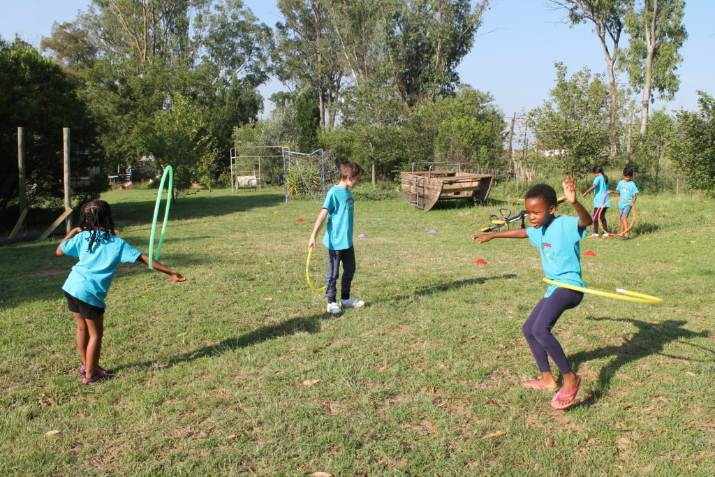 Hula Hooping in the garden of Expressions Junior Preparatory School