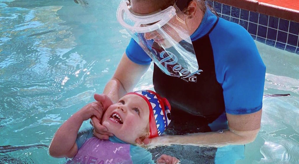 sarahs swim academy teacher with viros with toddler