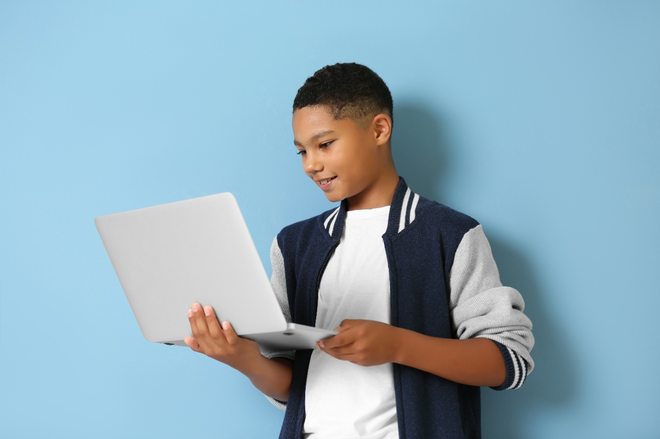 homeschooling guide boy on computer