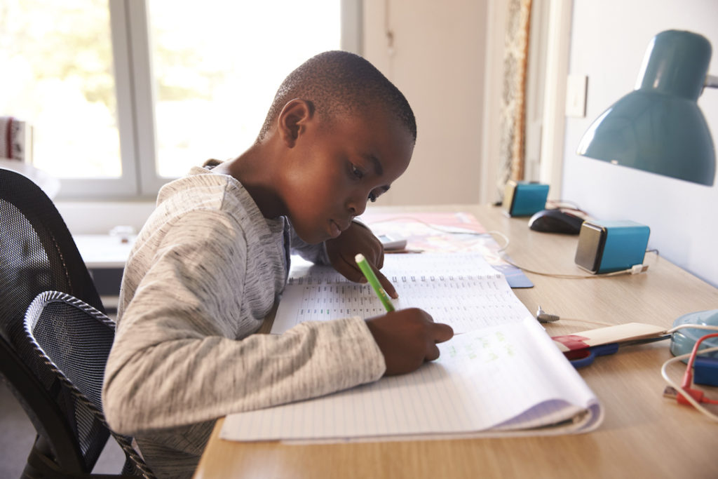 schooling options young black boy doing homework